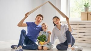 couple with child enjoying house after home remodeling contractors completed work