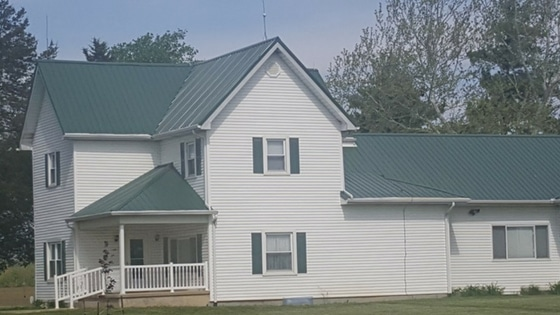 which is better metal roof or shingles old white house with metal