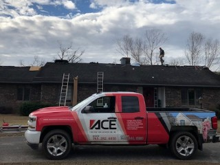 Recent home remodeling work (roofing) done on a home in Georgia damaged by Hurricane Michael. The Ace Construction truck is parked on the street in front of house.