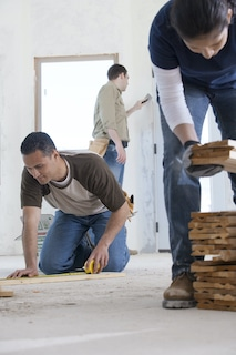 contractors measuring for cost of addition
