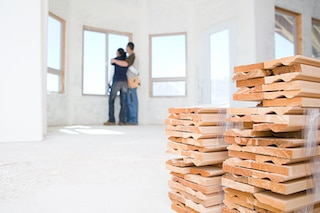 couple viewing windows on home addition cost
