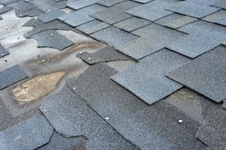 roofing contractor discovers hidden moisture under shingles