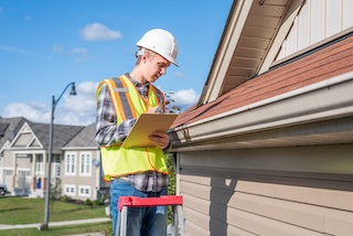 contractor with checklist for roofing inspection services