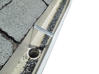 shingle granules in gutter shows signs you need a new roof