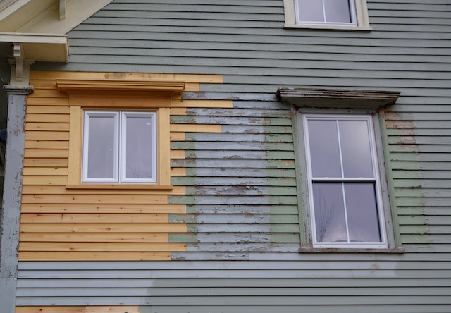 wood siding repairs around window on large old house