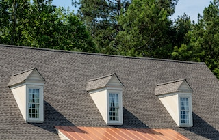 how much does a new roof cost with asphalt shingles and copper