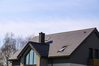 new roof cost showing beautifully finished roof with synthetic tiles