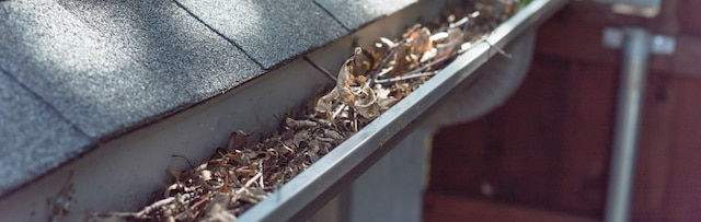 gutter cleaning is tip 4 in roofing maintenance