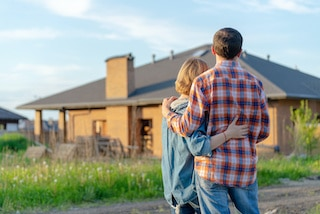 couple trying to decide on buying a house after roof inspectors report