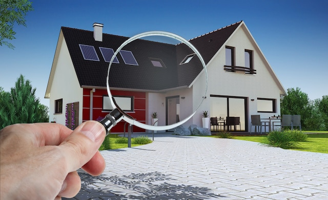 hiring roof inspectors with magnifying glass when buying a home saves you money