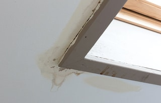 roofing inspectors report shows water stains on ceiling are indication of leaky roof