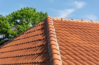 types of roofing includes spanish tiles in various shapes and materials