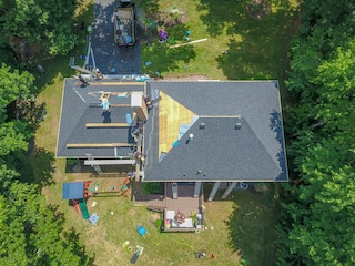 aerial photo of ace roofing remodelers and contractors working on roof
