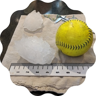 hail the size of softball causes hail damage on roofs